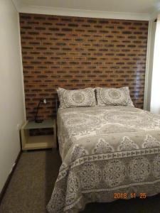 A bed or beds in a room at CCC - Central Clean Comfortable Apartment