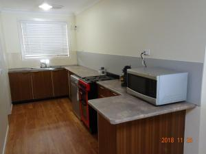 A kitchen or kitchenette at CCC - Central Clean Comfortable Apartment