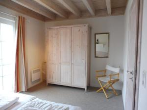 A bed or beds in a room at Doppelhaushälfte Windjammer