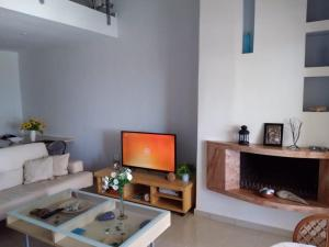 A television and/or entertainment center at Two-storey Beachfront Maisonette