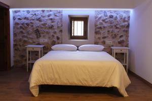 Cama o camas de una habitación en El Retiro del Pilar