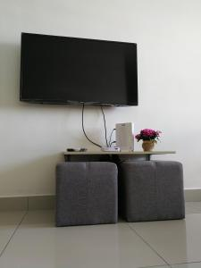 A television and/or entertainment centre at #3B2R# WIFI Cozy Apt Opp. #SPICE HomeStay