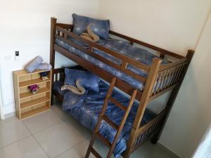 A bunk bed or bunk beds in a room at #3B2R# WIFI Cozy Apt Opp. #SPICE HomeStay