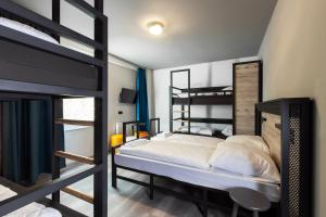 A bunk bed or bunk beds in a room at a&o Frankfurt Ostend