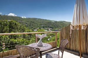 A balcony or terrace at Pearl Moon Boutique Suites