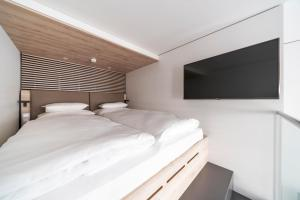 A bed or beds in a room at roomz Vienna Prater