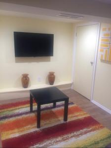 A television and/or entertainment center at The Hugh Suite