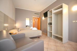 Een bed of bedden in een kamer bij Hotel Miramonti