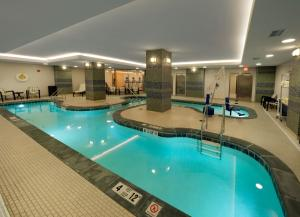 The swimming pool at or near The Hilton Garden Inn Buffalo-Downtown