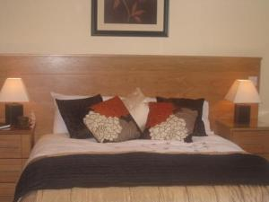A bed or beds in a room at Achill House
