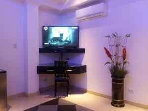 A television and/or entertainment center at Fields Walking Street Hotel