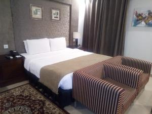 A bed or beds in a room at Hotel One Super