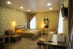 A bed or beds in a room at Lubas Apartment Monastery View