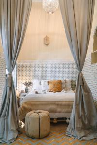 A bed or beds in a room at Riad Be Marrakech