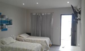 Una cama o camas en una habitación de Hotel El Recreo