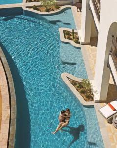 The swimming pool at or close to Secrets Puerto Los Cabos Golf & Spa18+