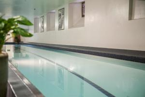 The swimming pool at or near OGB Suites