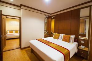 A bed or beds in a room at Chinatown Hotel