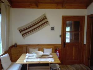 "A bed or beds in a room at Cabanas Peumayen ""La Panchita"""