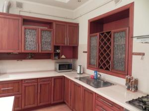 A kitchen or kitchenette at The Heart of Lviv Apartments - Lviv