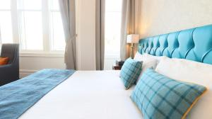 A bed or beds in a room at Columba Hotel Inverness by Compass Hospitality