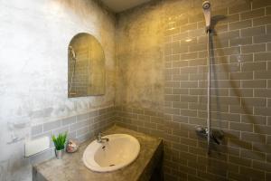 Ванная комната в Kata Bella Resort