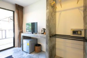 Телевизор и/или развлекательный центр в Kata Bella Resort