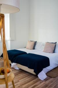 A bed or beds in a room at Vila Prata 1