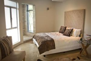 A bed or beds in a room at Moditlo River Lodge