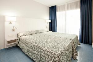 Cama o camas de una habitación en Olimar II