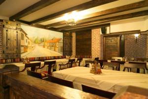 Ресторант или друго място за хранене в Kap House Family Hotel
