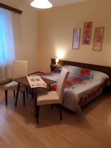 Letto o letti in una camera di Bella Italia