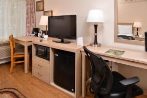 A television and/or entertainment center at Stage Coach Inn