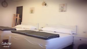 芹壁家適海景民宿房間的床