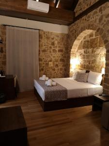 Ένα ή περισσότερα κρεβάτια σε δωμάτιο στο D'Argento Boutique Rooms