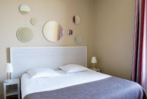 Un ou plusieurs lits dans un hébergement de l'établissement Résidence de Tourisme Vacances Bleues Villa Regina