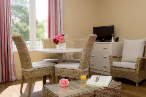 Coin salon dans l'établissement Résidence de Tourisme Vacances Bleues Villa Regina