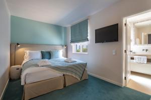 Cama o camas de una habitación en Vila Vita Parc Resort & Spa