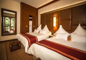Un ou plusieurs lits dans un hébergement de l'établissement Sumaq Machu Picchu Hotel