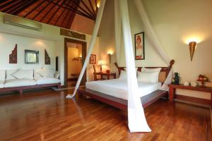 A bed or beds in a room at Ngapali Bay Villas & Spa