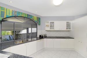 A kitchen or kitchenette at The Atrium, 11 Kentia Close
