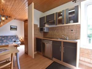 A kitchen or kitchenette at Cozy Apartment in La Bresse France near Ski Area