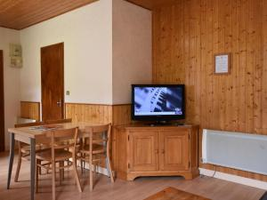 A television and/or entertainment center at Cozy Apartment in La Bresse France near Ski Area