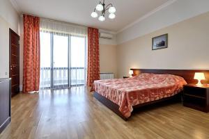 Кровать или кровати в номере Гостевой дом «Виктория»