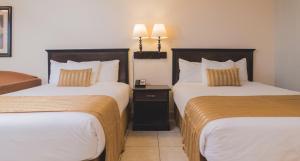 Cama ou camas em um quarto em Champions World Resort