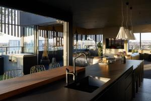 A restaurant or other place to eat at Birdcage Penthouse Luxury Melbourne Ultra Modern Industrial Chic