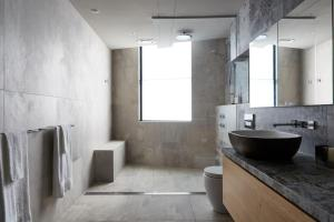 A bathroom at Birdcage Penthouse Luxury Melbourne Ultra Modern Industrial Chic