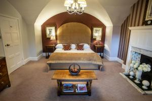 A bed or beds in a room at The Greenway Hotel & Spa