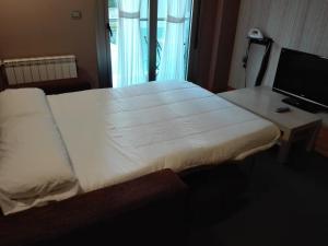 Cama o camas de una habitación en Apartamentos Spa Cueto