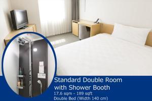 Tempat tidur dalam kamar di Kobe Motomachi Tokyu REI Hotel